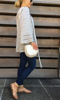 I Love my cross body bag by Rebecca Minkoff. Great neutral color that matches everything.
