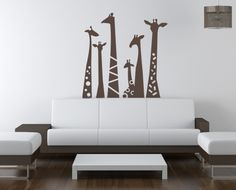 This would be so cute for a giraffe, zoo, or jungle themed nursery.   Giraffe Necks Wall Decal from www.tradingphrases.com