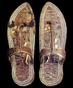 Sandals that belonged to #Tutankhamun. The bottoms are decorated with images of bound captives from enemy nations, so that the Pharaoh would symbolically be stepping on and destroying his enemies when he walked. #AncientEgypt