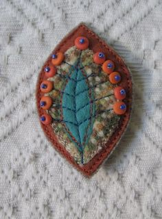 (via Felt Brooch by MilenaMisheva on Etsy)