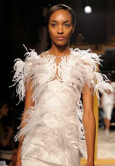 be daring on your wedding dress with feathers