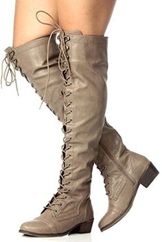 9137dc0347a These over-the-knee boots feature a round toe front