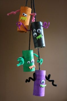 Monster Mobile - cardboard tube monsters Halloween decorations for toddlers and preschoolers to make  - happy hooligans