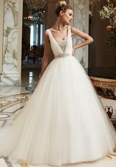 Gown features crystal and rhinestone beading, embroidery and sash.