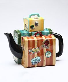 Brew up a pot of your favorite tea in this clever luggage-shaped teapot, made from ceramic for lasting enjoyment.