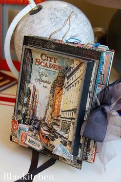 Travel Album City Scapes by Marina Blaukitchen, Product by Graphic 45 Tip: you can get more depth curling little  pieces of cardstock and sticking them at different levels and layers.""