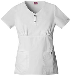 """A Henley style neckline top features functional snaps and an empire waist with bust shirring for shape. Curved front patch pockets, right pocket has an extra exterior pocket with a pen slot and left pocket has a tab with a functional snap. Contrast multi-needle top stitching, back elastic and side vents complete the picture. Center back length: 25""""."""