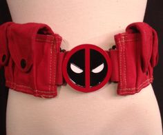 Deadpool Pouch Belt - $175.00 This is a red hand dyed cotton canvas pouch/utility Deadpool belt. Belt comes with Deadpool buckle as shown and large plastic slide release buckle closure in back. Belt is adjustable but please provide your high hip measurement in the notes section at check out for sizing.