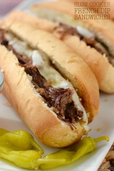 These Slow Cooker French Dip Sandwiches from are easy and packed with flavor! Perfect for an easy weeknight meal or to feed a crowd!
