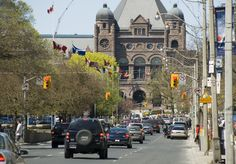 Toronto.  University Avenue near College Street, with the Ontario Legislative Building visible in the background