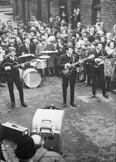 Police had to control hundreds of fans who mobbed the Bootle based group The Searchers in Deacon Street Everton. The group were filming for the BBC TV show Pick of the Pops.