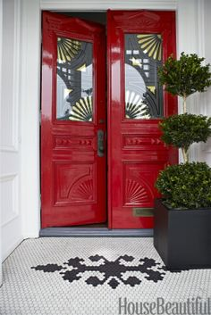 Benjamin Moore Heritage Red front door with gilt stencils on the glass, on a Victorian-style house.