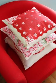 Vintage hanky pillow covers love it. Hard to find hanky, easier to find scarves. But scarves too large without quartering. hmm what to do?  love the red color on these cushions