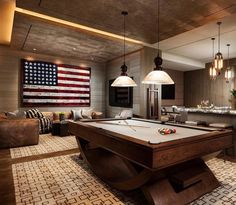 This game room is complete with a gorgeous wine cellar, pool table ...