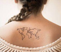 World map tattoo on the upper back. Tattoo artist: Mariló Alonso