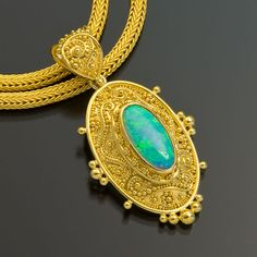 Zaffiro Jewelry Classic Collection — Tuscan Garden Pendant  Pendant is set with a White Opal (1.89cts) in granulated 22kt yellow gold with 18kt yellow gold.