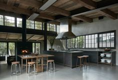 Rustic industrial kitchen/dining space in a large open plan living area made of weathered wooden beams and other recycled materials, Wentworth-Nord, rural Quebec, Canada Industrial House, Industrial Furniture, Industrial Office, Industrial Table, Industrial Farmhouse, Industrial Kitchens, Industrial Bookshelf, Industrial Windows, Industrial Bedroom