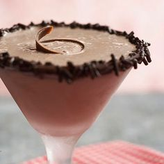 chocolate blitzen | 2 ounces semisweet chocolate 1/3 cup chocolate sprinkles 1 cup chocolate ice cream 1/4 cup irish cream liqueur 2 tbsps cream de cacao 2 tbsps vodka chocolate curls or grated chocolate | heat chocolate over low heat until melted. dip rims of eight 1-ounce mini martini or shot glasses in melted chocolate and dip in sprinkles. chill. in a blender, combine ice cream, irish cream liqueur, cream de cacao, and vodka. blend smooth. pour into glasses. garnish with chocolate curls.
