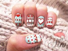 A fun looking fall inspired nail art with blue, red and white color combination.