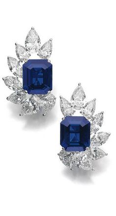 Pair of very fine and rare sapphire and diamond ear clips, Cartier Each set with a step-cut sapphire weighing 15.77 and 16.90 carats, within a semi circle of pear- and marquise-shaped diamonds weighing a total of approximately 21.54 carats, signed Cartier, numbered, French assay marks, case stamped Cartier.