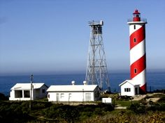 Lighthouses of S Africa Ystervarkpunt Lighthouse is situated within Rein's Nature Reserve, located halfway between the coastal towns of Gouritsmond and Stilbaai in the Southern Cape. The reserve is accessible to the public, but you cannot enter the Lighthouse's premises (although you can easily drive up to its gates). When I visited the site in 2003, they were finished with the construction of the new tower (right), but the light has not been moved yet.