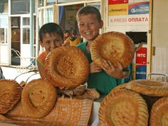 Kids at the Market with Uzbek Bread or non.