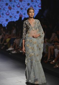Powder blue saree with navy blue floral applique blouse available only at Pernia's Pop Up Shop.