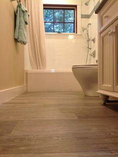 Porcelain tile that looks like hardwood.  Neutral color.