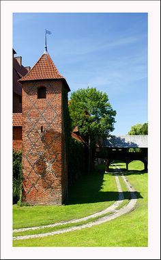 This is the Malbork Castle, if you remember, this fortress was built by the Teutonic Order in XIV-XV centuries. On the photo you can see the stamps of these battles. Malbork Castle, Chateaus, Cathedrals, Poland, Medieval, Stamps, Places To Visit, Sidewalk, Europe