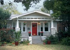 painted gray brick home-exterior-inspiration cover wrought iron with similar pillars