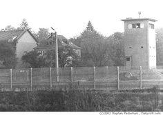 Berliner Mauer - Berlin 1983 - border fence and watchtower in Teltow.  Blick über den Teltowkanal nach Teltow, Seehof  Photo: (c) 2002 Stephan Pastenaci