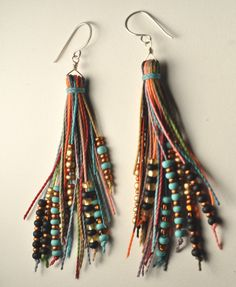 feather fringe earrings. $38.00, via Etsy.  I think these would be very easy and inexpensive to make, gonna try