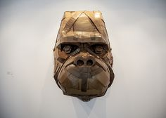 A gorilla head made out of cardboard. Artist: Laurence Vallières Photo of José Enrique Montes Hernandez at Yves Laroche Gallery, Montreal.