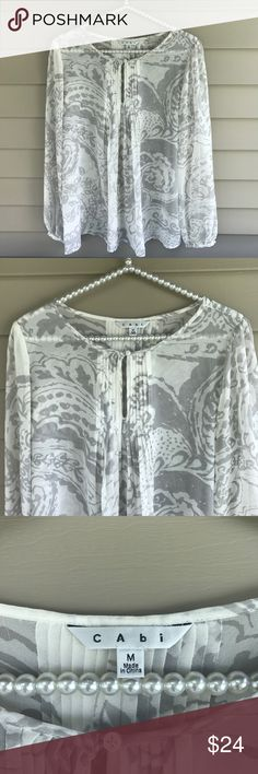 CAbi Pleated Peasant Pintuck Blouse Style# 634 Great condition CAbi top.  Style# 634.  Top is see through so you will want to wear a camisole underneath.  100% Polyester.  Size: medium.  Very cute! CAbi Tops Blouses