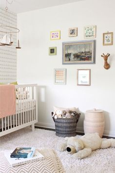 We're really liking the space between the frames for this sweet muted nursery's gallery wall.