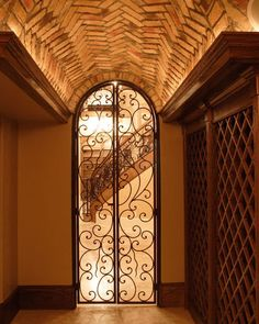Repurpose a salvaged wrought iron gate, a screen door such as this will add beauty and security to your home while keeping it bug free.