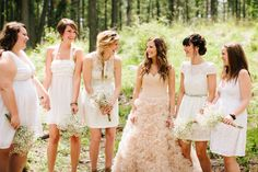 wedding party with a twist. bridesmaids in white and the beautiful bride in blush  Photography By / http://cluneyphoto.com