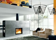 modern fireplace design.  Focal point.  Tv mounted?  I picture near center for effective warmth.