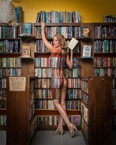 """Cici James -- founder of Brooklyn's science fiction bookstore Singularity and Co -- posed for a body-painted portrait amongst her wares."" Photo by Bill Wadman, body paint by Adam DuShole."
