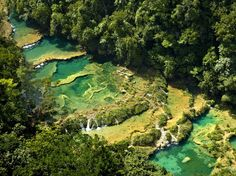 Guatemala's Semuc Champey is a paradise for those in search of turquoise waters hidden amidst a lush landscape. Though the ride there can be bumpy, once you arrive, you'll find a limestone bridge with a series of natural pools that provide cool waters ideal for swimming.