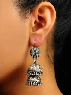 Why go for gold always? These two tiered silver jhumkas can add an ethnic appeal to just about any outfit Silver Jhumkas, Silver Jewellery Indian, Indian Wedding Jewelry, Tribal Jewelry, Metal Jewelry, Jewelry Art, Antique Jewelry, Silver Jewelry, Jewelry Design