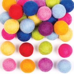 10 assorted colours - Green, Yellow, Dark Blue, Light Blue, Purple, Lilac, Orange, Dark Orange, Red & Bright Pink#Handmade from 100% lambswool#Ball size 20mm-25mm diameter#Use to make beautiful mobiles, garlands, coasters and jewellery or add to costumes#Size may vary because each bead is made individually#There is no hole but it is easy to pierce using just a regular needle