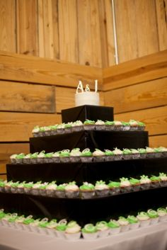 wedding cupcake tower. Black, white, and apple green.
