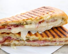 Thinly shaved prosciutto, hunk of fresh mozzarella, slices of juicy heirloom tomatoes, drizzle of extra virgin olive oil, sprinkle of basil and Herbes de Provence. Served between two slices of house-baked bread (hot off the panini grill.)