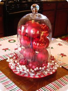 such an easy holiday centerpiece...just a simple vase and Christmas ornaments