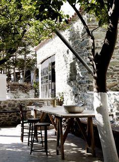 White stone building + quaint dining area