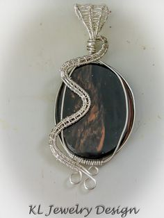 $29.50 Petrified Wood in Woven Silver Pendant by KLJewelryDesign on Etsy