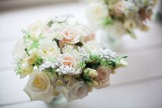 Soft delicate wedding bouquet filled with pretty pastel colours. Cream roses, light pink roses, and a tiny bit of baby breath.