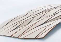 Wooden Mesh by Diego Vencato, Fabric + wood pieces = new skin