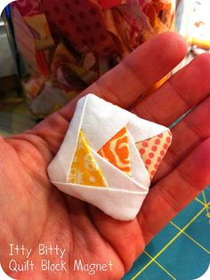 would be a very cute pincushion! Itty Bitty Quilt Block Magnet by Cara , via Flickr;